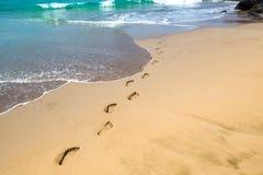 在沙子的脚印 免版税库存照片