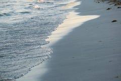 在沙子的通知 图库摄影
