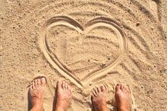在沙子的重点符号 免版税库存照片