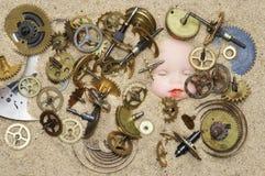 在沙子的钟表机构机制 免版税库存图片