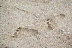 在沙子的婴孩脚印 免版税库存图片