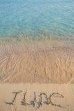 在沙子的6月 库存照片