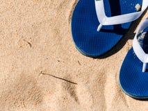 在沙子的轻碰flpos 库存照片