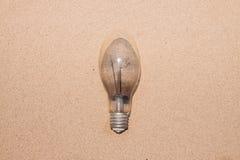 在沙子背景的灯 免版税库存照片