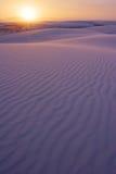 在沙子落日白色的nm 免版税库存照片