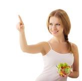 在沙拉素食主义者白色的美丽的女孩 免版税库存图片