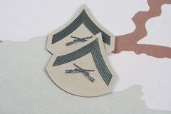 在沙漠制服的美国海军陆战队一等兵茂盛的补丁 免版税库存照片