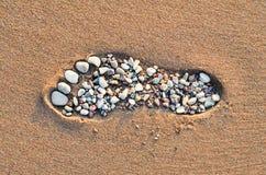 在沙滩的脚步 免版税库存图片