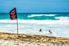 在没有游泳红旗下的旅游游泳 库存照片