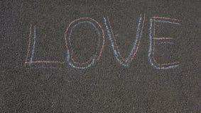 在沥青爱的题字 库存图片