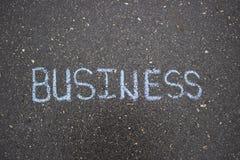 在沥青白垩的白色简单的企业图画 免版税图库摄影