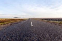 在沥青的农村路 免版税库存图片