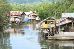 在河上的恶劣的房子 库存照片