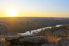 在河南部的臭虫的日落秋天 库存照片