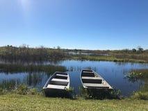 在河的岸的两条小船 免版税库存照片