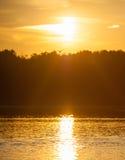 在河的日落 免版税库存照片