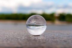 在河背景的玻璃透明球和 图库摄影
