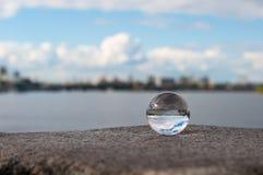 在河背景的玻璃透明球和 库存照片