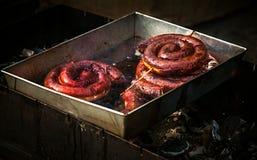 在油油煎的猪肉香肠 图库摄影