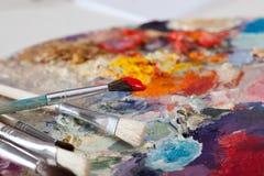 在油漆的刷子 免版税库存照片