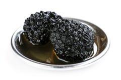 在油的黑块菌蘑菇 免版税图库摄影