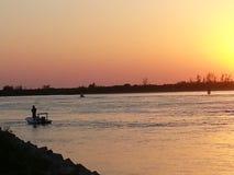在沿海运河的日落 库存图片