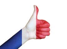 在法国的旗子报道的手 免版税库存照片