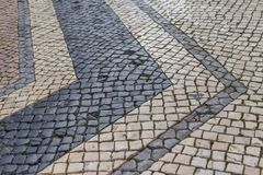 在法鲁街道上的一块古老葡萄牙铺路石  免版税图库摄影
