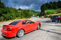 在泛美的高速公路的红色Sportscar在危地马拉 免版税库存照片