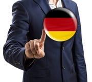 在泡影的商人点与德国旗子 免版税库存照片