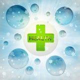 在泡影的绿色健康十字架在冬天降雪 免版税库存照片