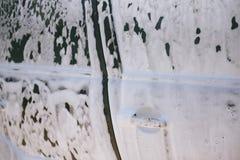 在泡沫的汽车 E 在泡沫的汽车从洗涤剂 免版税图库摄影