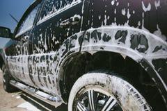 在泡沫的汽车 E 在泡沫的汽车从洗涤剂 免版税库存图片