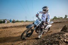 在波兰摩托车越野赛冠军的未定义车手 图库摄影