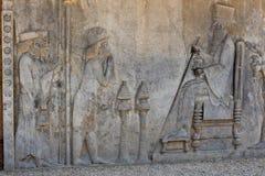 在波斯波利斯古城的墙壁上的符号安心 库存图片
