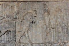 在波斯波利斯古城的墙壁上的符号安心 免版税库存照片