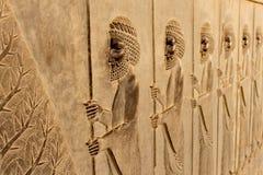 在波斯波利斯古城的墙壁上的符号安心 免版税图库摄影