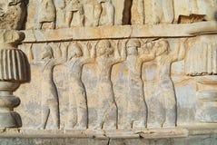在波斯波利斯废墟的浅浮雕在设拉子,伊朗 免版税库存照片