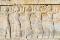 在波斯波利斯废墟的浅浮雕在设拉子,伊朗 免版税图库摄影