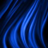 在波浪折叠装饰的蓝色材料,与黑阴影的典雅的豪华蓝色背景设计 库存例证