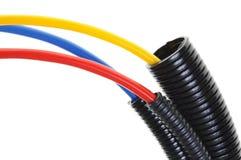 在波纹状的管子的供电电缆 免版税库存照片