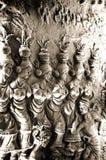 在泥墙壁上的地方艺术品黏土雕塑 库存图片