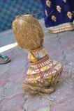 在泥罐的椰子有树叶子的 图库摄影