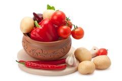 在泥罐的蔬菜 库存照片
