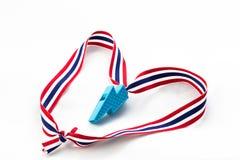 在泰国旗子小条的蓝色口哨在爱标志 图库摄影