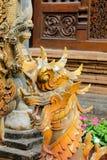 在泰国wat的Qilin亚洲神话木雕象 免版税图库摄影