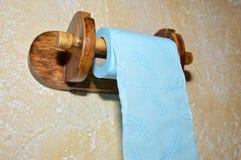 在洗手间的一张蓝色卫生纸 库存图片
