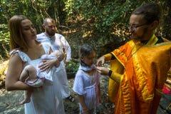 在洗礼-精神诞生的基督徒圣礼期间 免版税图库摄影