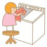 在洗衣店的女孩帮助 免版税图库摄影