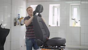 在洗车的专业工作者清洁汽车座位 影视素材